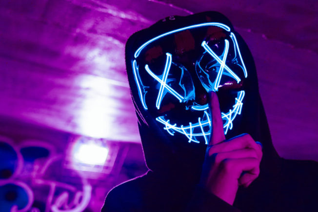 DJ Wearing LED Purge Mask Doing Silence Gesture