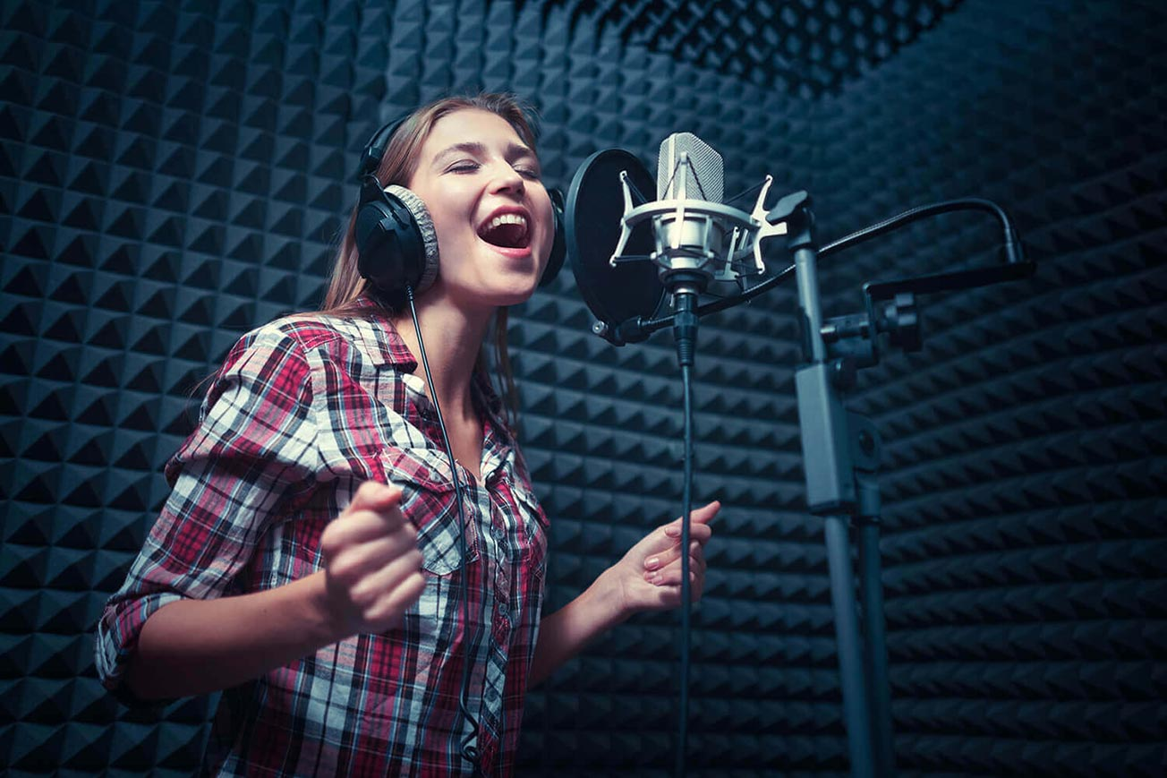 Girl in Vocal Booth Practicing Best Vocal Warm-Ups