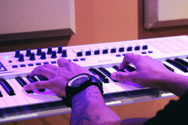 Man Playing Arturia Keyboard