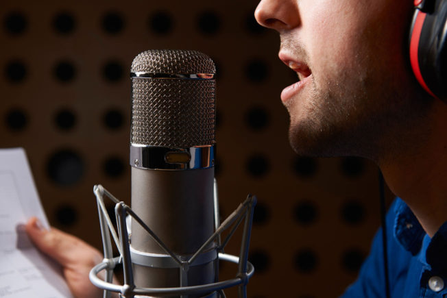 Man Singing in Microphone