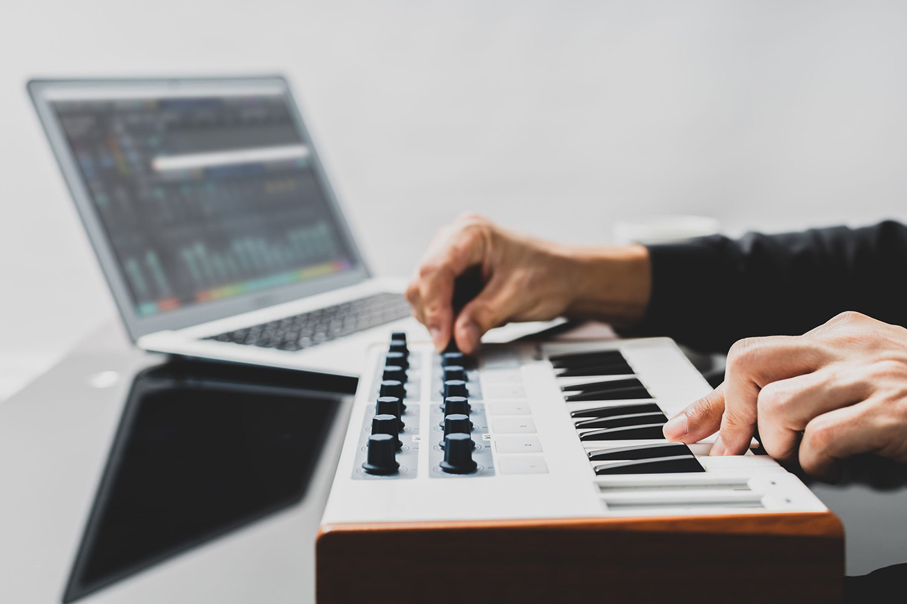 Music Producer Playing Synthesizer