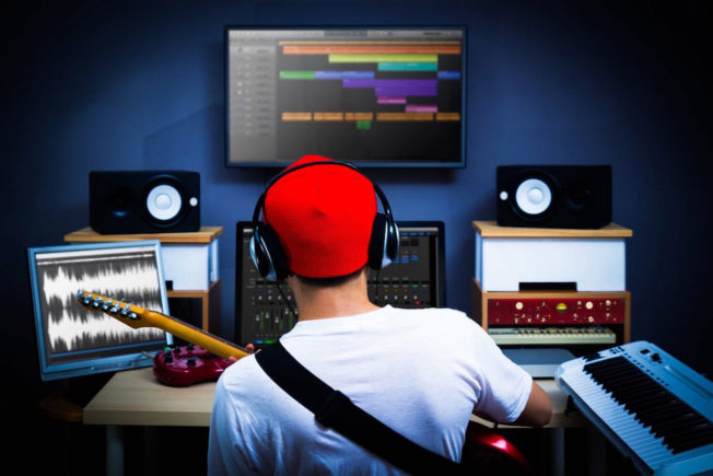 Music Producer in a Music Studio - Play an Instrument