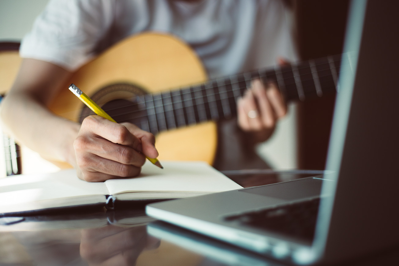 Songwriting with Notepad and Guitar