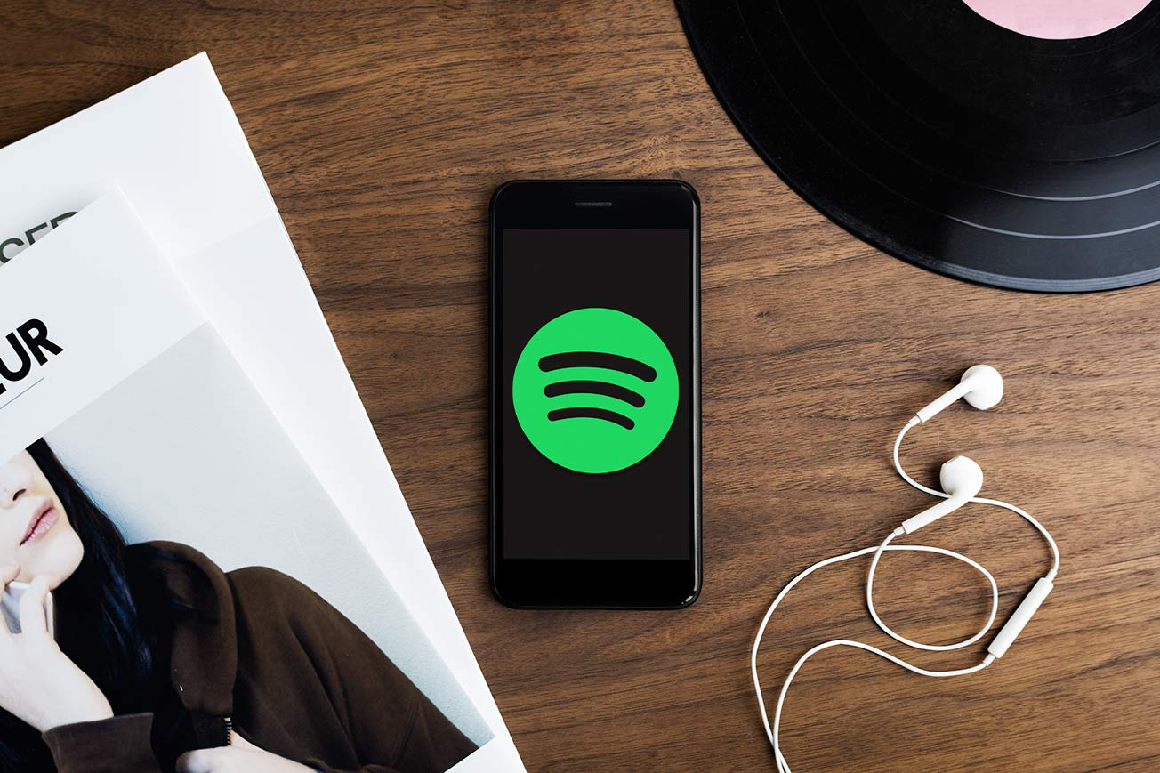 Spotify Music Streaming on Mobile Phone with Headphones and Vinyl Record